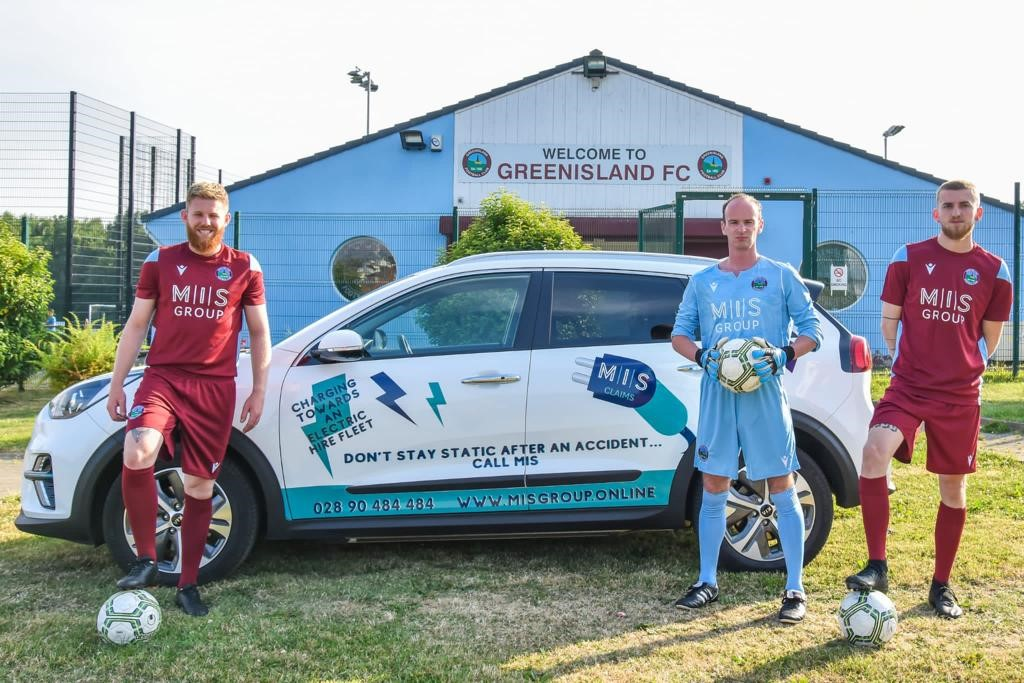 Members of Greenisland Football club pictured with the MIS Claims Electric Vehicle at the Greenisland Football Club grounds.
